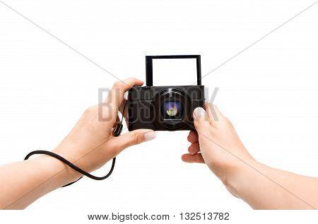 Hand digital camera isolated on white background.