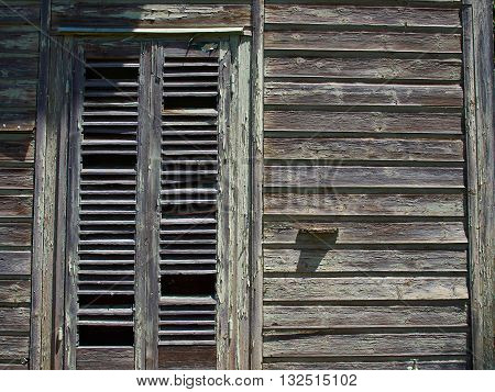 Details of an old weathered abandoned western colonial style wooden house shed