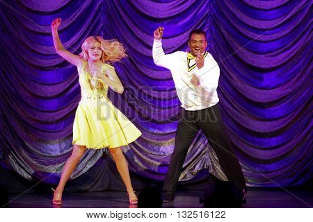 NEW YORK-JAN 12: Witney Carson (L) and Alfonso Ribeiro perform at Dancing with the Stars: Live! Tour at the Beacon Theatre on January 15, 2015 in New York City.
