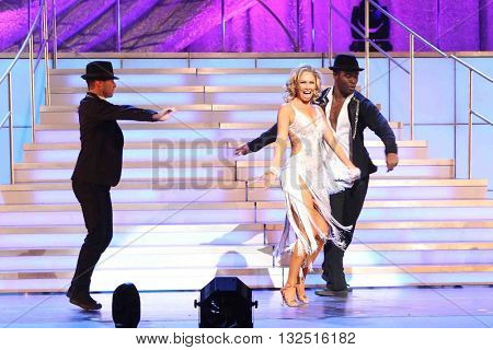 NEW YORK-JAN 12: Kym Johnson (C) and Keo Motsepe (R)perform at Dancing with the Stars: Live! Tour at the Beacon Theatre on January 15, 2015 in New York City.