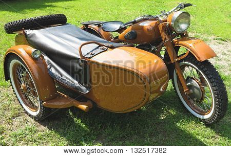 vintage motorcycle with sidecar parked on green grass