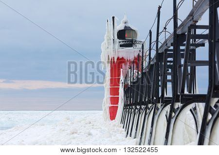 Ice covered South Haven Lighthouse in winter, along the shores of Lake Michigan