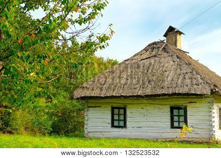 A old farmhouse with a thatched roof