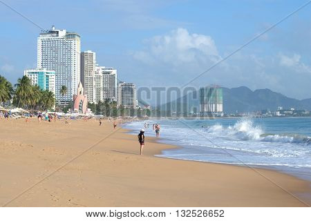 NHA TRANG, VIETNAM - DECEMBER 30, 2015: A strong surf on the beach of Nha Trang. The big tourist beach in Vietnam