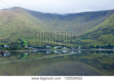 A view of Leenane Village, Connemara, Co. Galway, Ireland across Killary Fjord.
