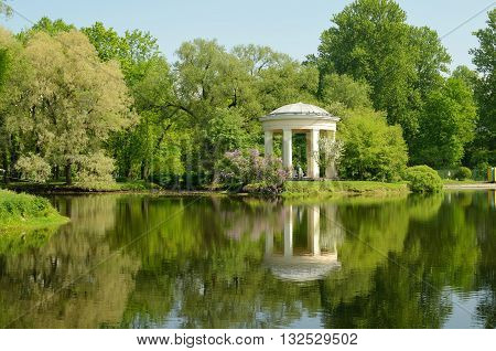 Russia.Saint-Petersburg.Rotunda-gazebo in the Park the Ekateringofka stands on the shore of the pond.Park-a favorite place of citizens.