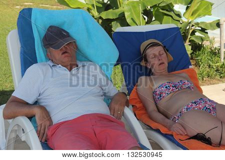25TH MAY 2016, CALIS, TURKEY: Two unknown English tourists asleep on sunbeds in the shade at a hotel in calis, turkey,25th may 2016