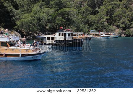 FETHIYE,TURKEY- 26TH MAY  2016 : Turkish pleasure boats on a trip with passengers in a bay near Fethiye, Turkey , 26th may 2016