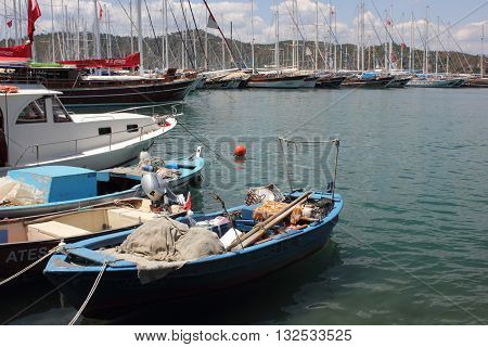 27TH MAY 2016, FETHIYE, TURKEY: Fishing boats moored along the promenade at Fethiye in Turkey, 27th may 2016