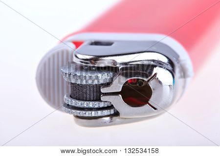 Red lighter isolated on white background. MACRO