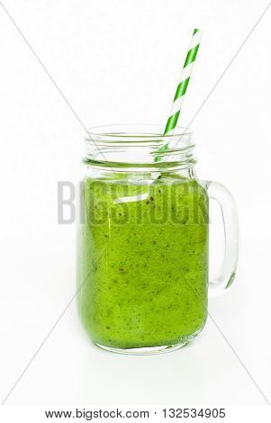 Smoothie isolated. Green smoothie in mason jar isolated on white.