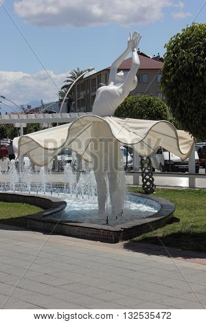 27TH MAY FETHIYE, TURKEY: A water fountain ballerina along the prom in fethiye in turkey 2016