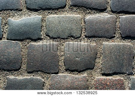Abstract background of old cobblestone pavement. stone pavement texture