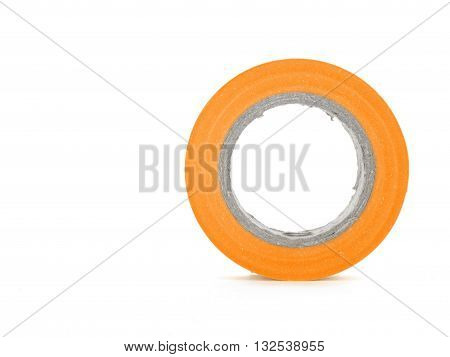 Protecting sticky orange insulating tape coil isolated on white background