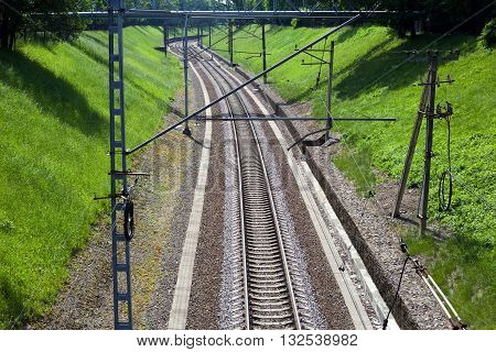 View at old curving railway single-track with poles