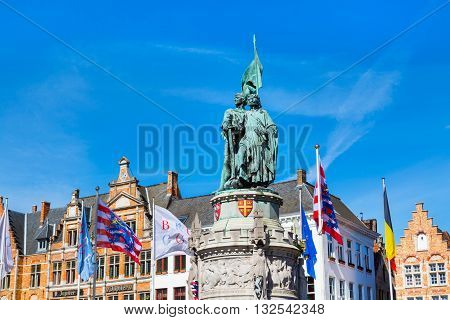 Bruges, Belgium - April 10, 2016: Statues of Jan Breydel and Pieter de Coninck at Grote Markt in Brugge, Belguim