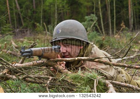 American World War II infantry soldier prepering for shooting