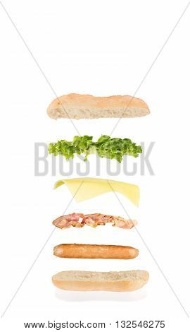 hot dog sandwich with sausage bacon cheese and lettuce