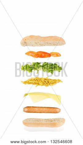 hot dog sandwich with sausage cheese chips lettuce and tomato
