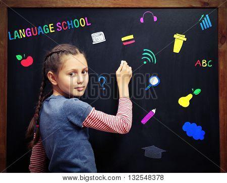 Language school concept with schoolgirl
