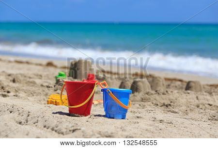 kids play on sand beach concept- toys and sandcastle