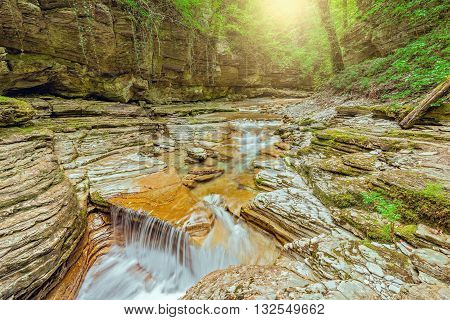 Creek with pure water in the deep canyon. Caucasus. Russia.