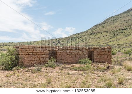 The ruin of a farm building built from stone next to the road between Steynsburg and Hofmeyer in the Eastern Cape Province of South Africa