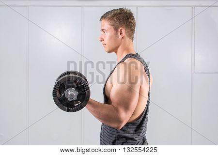 Man Performing Biceps Workout