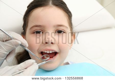Cute little girl in the dentist chair, close up