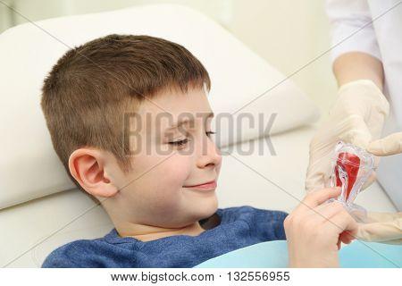 Cute little boy in the dentist chair, close up