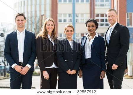 Group Of Happy Multi-racial Businesspeople Standing Together