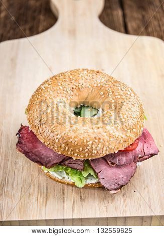 Bagel (with Roast Beef) On Vintage Background