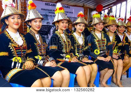 Penampang,Sabah-May 31,2016: Group of Kadazandusun girls native wearing traditional costumes during Sabah Harvest festival celebration in Kota Kinabalu, Sabah Borneo, Malaysia.