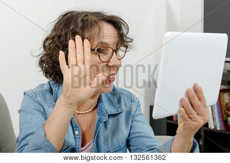 a middle-aged woman making a distant call on internet