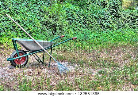 Hdr Of Wheelbarrow In A Garden
