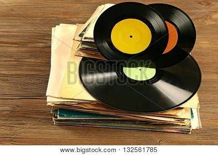 Pile of old vinyl records on wooden table