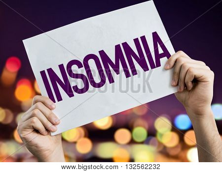 Insomnia placard with night lights on background