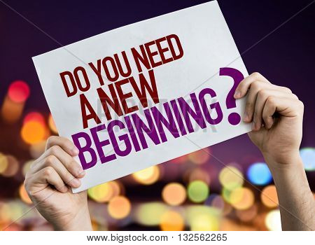 Do You Need a New Beginning? placard with night lights on background
