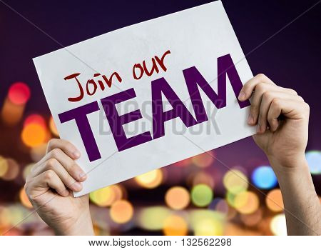 Join Our Team placard with night lights on background