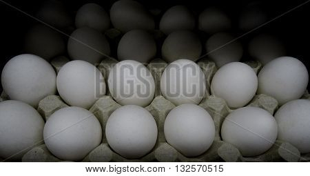 Raw eggs in carton tray closeup stock photos