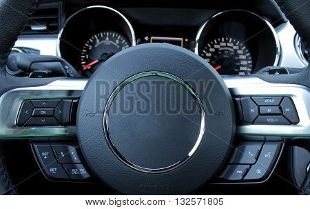 Dashboard and steering wheel inside of the sport car