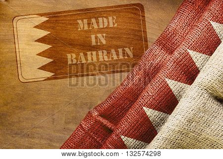 Symbol Bahrain industry Impression Made in Bahrain and the country's national flag.