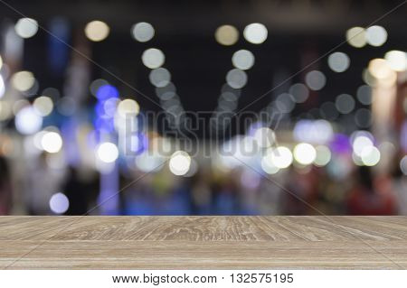 Wooden Table For Display Or Montage Your Product With Blur Background Of People In Exhibition Hall B
