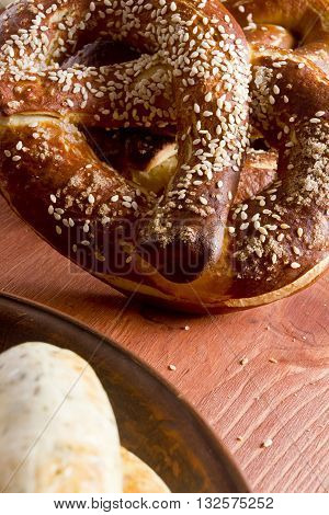 Typical German pretzel for a beer on a wooden table