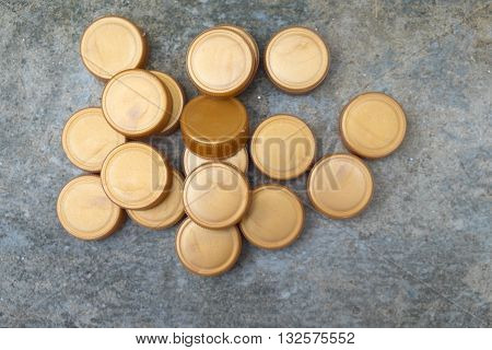 group of Recycled gold plastic bottle caps