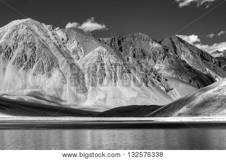 Beautiful Mountains and Pangong tso (Lake). It is a huge lake in Ladakh extends from India to Tibet. Leh Ladakh Jammu and Kashmir India. Himalayan mountains in background. Black and white image.