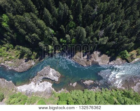arial shot of a river through a forest