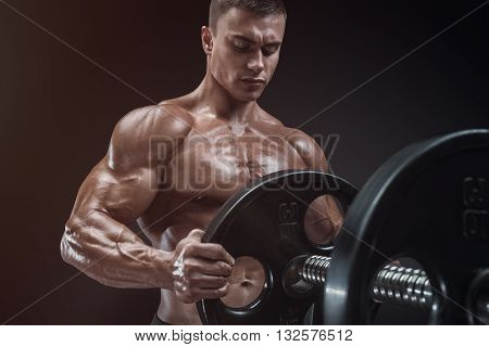 Bodybuilder Prepare To Do Exercises With Barbell