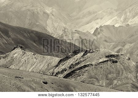 Nice Sepia tinted rocks of Moonland landscape Leh Jammu Kashmir India. The Moonland part of Himalayan mountain is famous for rock formation texture which looks like a part of moon on earth.