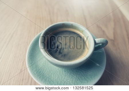 Espresso Coffee cup on wood table ( Filtered image processed vintage effect. )